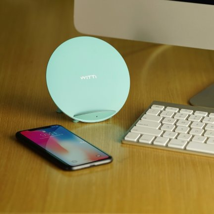 tiffany blue candy wireless charging station on desk next to phone