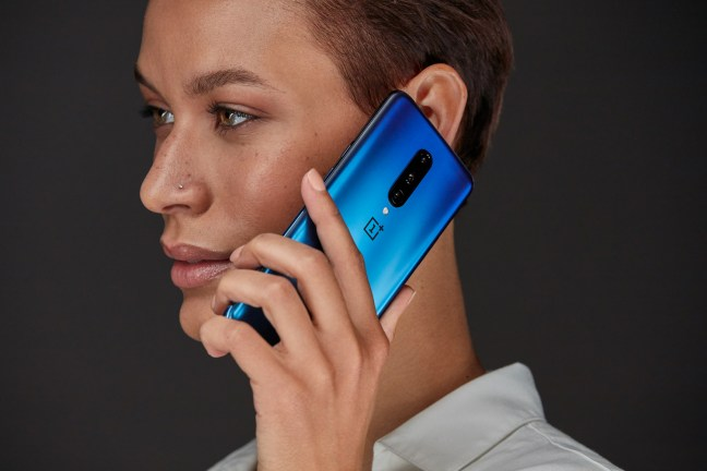 Person with Nebula Blue OnePlus 7 Pro smartphone