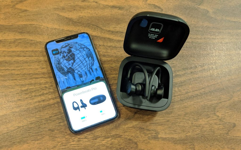 phone on the left. black fold Powerbeats Pro case (right)