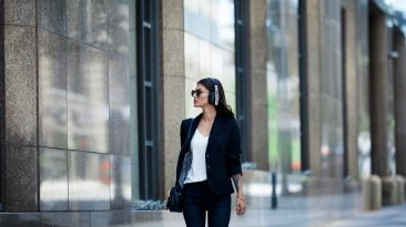 woman walking wearing headphones