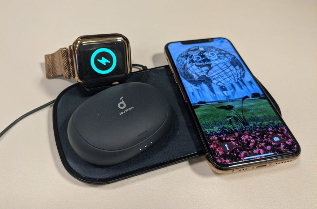 mophie 3-in-1 charging pad with iphone, apple watch, and soundcore earbuds